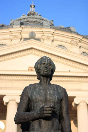 national poet: The statue of Romanian National Poet: Mihai Eminescu, placed in front of the Ateneul Roman (Romanian Athenaeum) Stock Photo