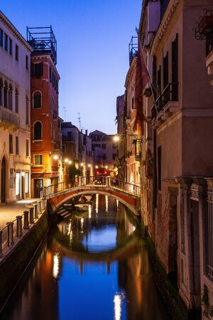 A canal view in Venice, Italy at blue hour before sunrise