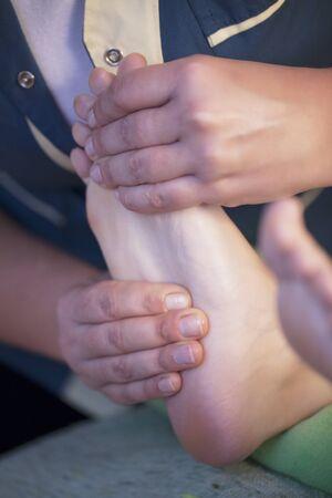 vertical wellness: Feet massage Stock Photo
