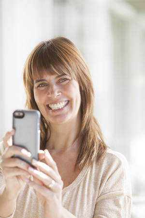 30 34 years: Adult woman with mobile phone Stock Photo