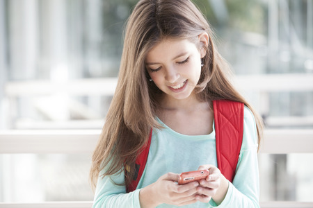 8 10 years: Little girl texting