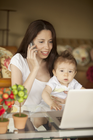 Woman Working at Home with Baby Stock Photo