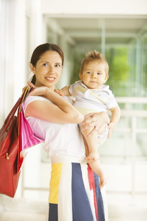 6 12 months: Woman shopping with son