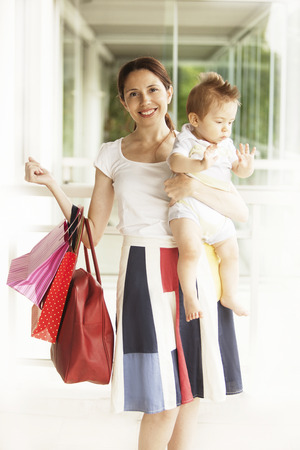 6 12 months: Mother shopping with baby