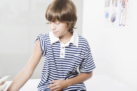 pre adolescence: Boy going receiving vaccination