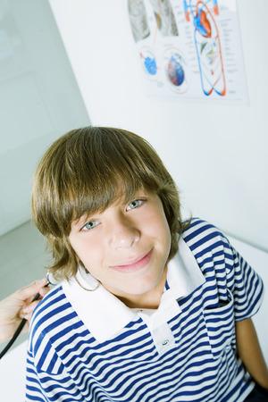 pre adolescence: Boy going under medical exam