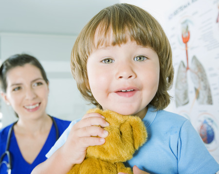 12 18 months: Little boy being examined by pediatrician