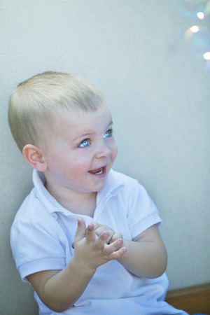 12 18 months: Beautiful blonde little baby boy playing Stock Photo
