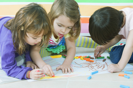 home schooling: Little friends drawing at kindergarten Stock Photo