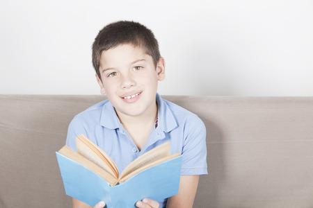 pre adolescence: Happy boy reading a book