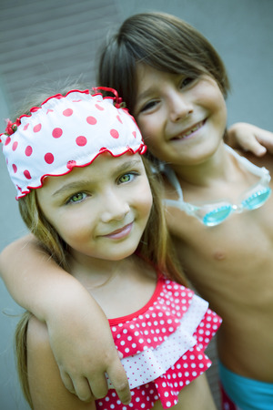 two people only: Happy siblings wearing swimsuit