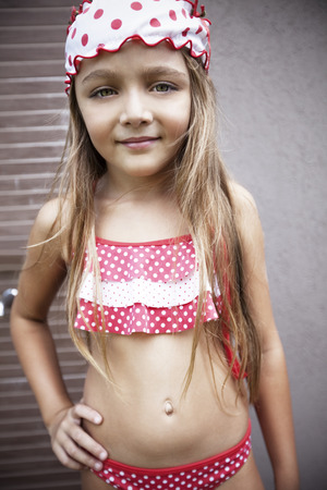 one child only: Happy little girl wearing swimsuit