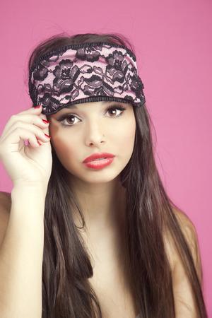 sleep mask: Beautiful young woman with sleep mask