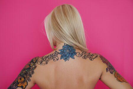 tattoed: Tattooed woman back Stock Photo