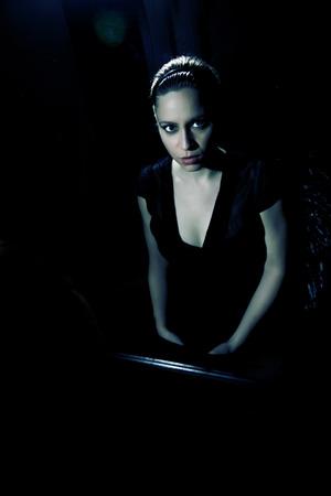 Dark woman dressed in black