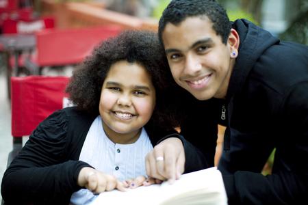 siblings: Happy african american siblings studying