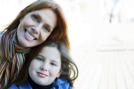 10 11 years: Happy mother and daughter smiling outdoors Stock Photo