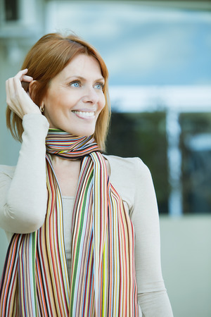 40 44 years: Happy adult woman smiling Stock Photo