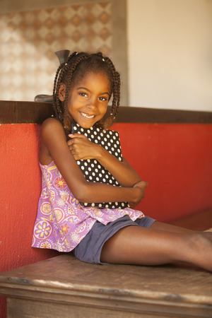 brazilian ethnicity: Happy african american little girl with book