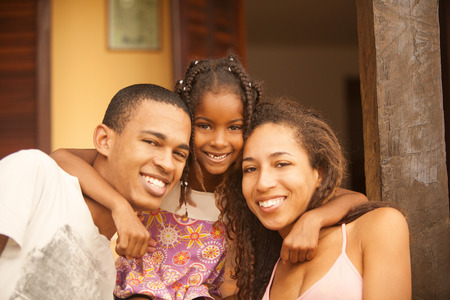 poor man: Happy african american family Stock Photo