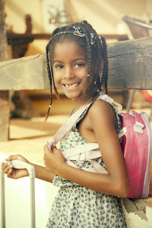 brazilian ethnicity: Happy african american little girl with backpack