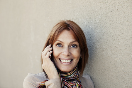 40 44 years: Happy adult woman on the phone, smiling Stock Photo