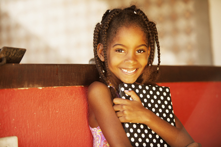 culture school: Happy african american girl with digital tablet