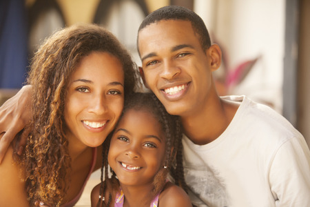 american content: Happy african american family smiling Stock Photo