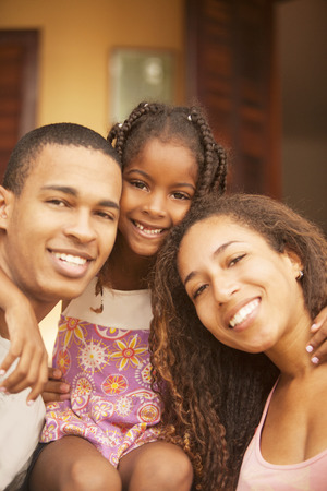 poor child: Happy african american family smiling Stock Photo