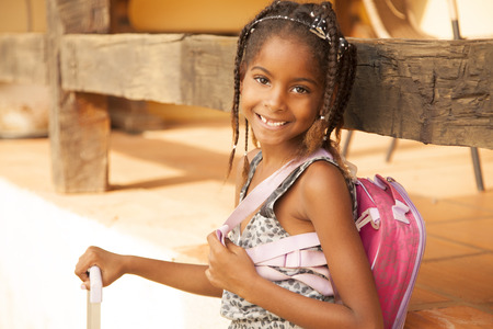 school girl: Happy african american girl with backpack, back to school