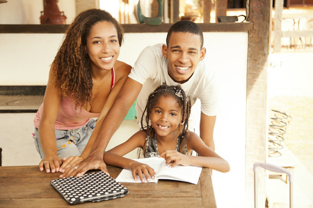 adult family: Happy african american family studying