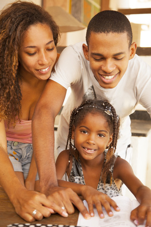 Happy african american family studying photo