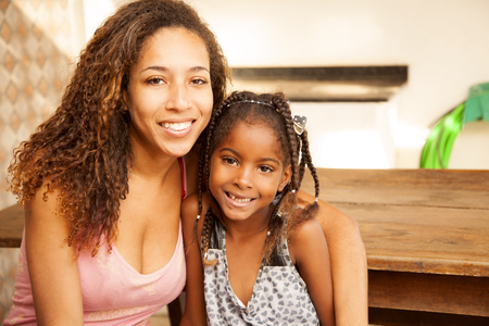 Happy african american mother and daughter smiling photo