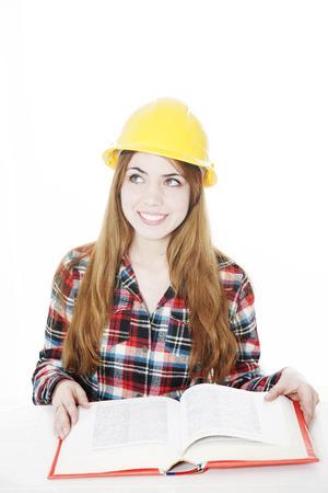 female architect: Happy female architect with book, isolated on white Stock Photo