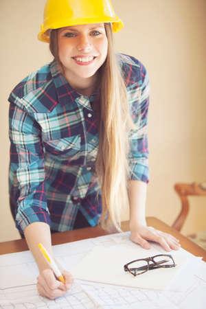 female architect: Female architect working in office Stock Photo