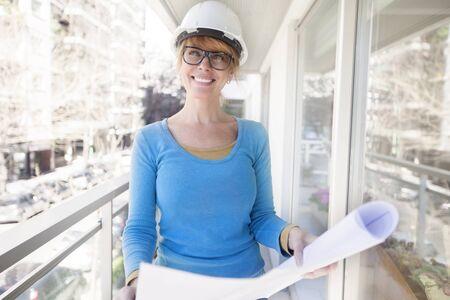 female architect: Happy female architect smiling outdoors