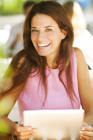Happy woman with digital tablet photo