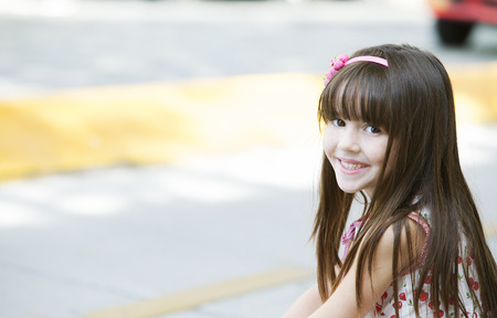 elementary age girls: Happy little girl outdoors Stock Photo