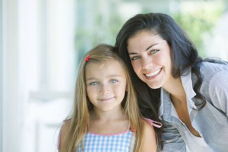 only two people: Happy mother and daughter portrait