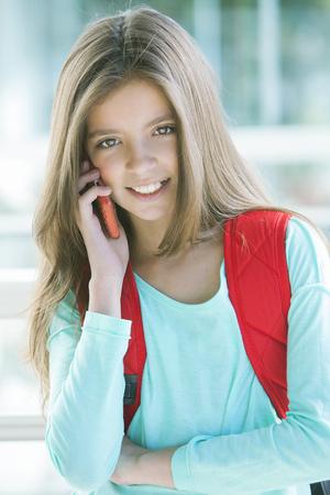 hi back: Happy girl on the phone