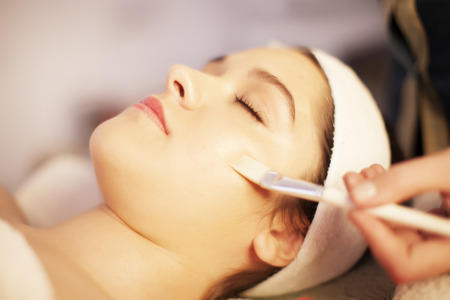 woman in spa: Facial mask spa treatment Stock Photo
