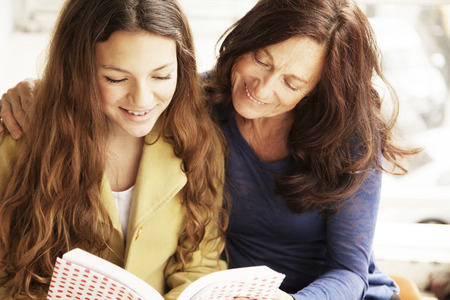 only teenage girls: Happy girl with grandmother studying