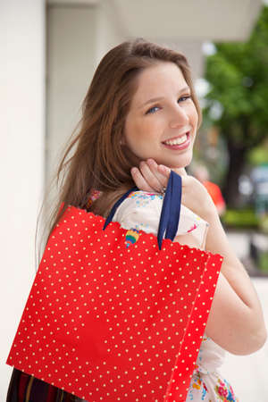 personal perspective: Happy woman with shopping bag