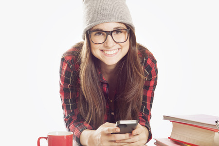 cel: Happy student with mobile phone and glasses Stock Photo