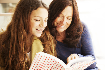 only teenage girls: Girl and grandmother reading