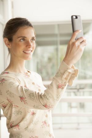 self   portrait: Happy woman taking a self portrait