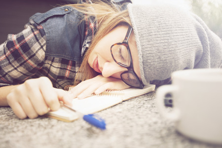 sleep: Tired student slleping over the desk Stock Photo