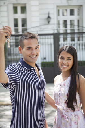 latin couple: Happy young latin couple with house keys Stock Photo