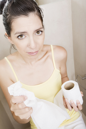 constipated: Woman in the bathroom
