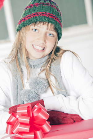 preadolescent: Girl opening Christmas presents